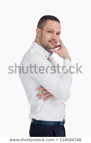 thoughtful man standing and crossing his arms against a white background stock photo © wavebreak_media