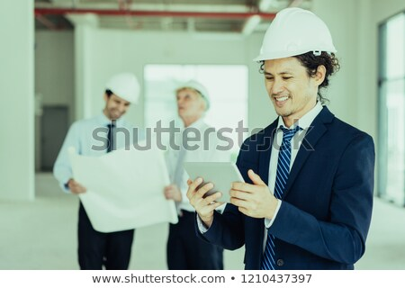 A mature architect reviewing his plans. Stock photo © photography33