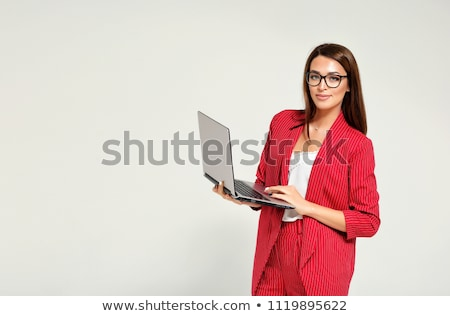 young woman in a red pantsuit stock photo © acidgrey