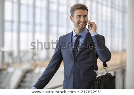 işkadını · ayakta · telefon · beyaz · takım · elbise · konuşma - stok fotoğraf © hasloo