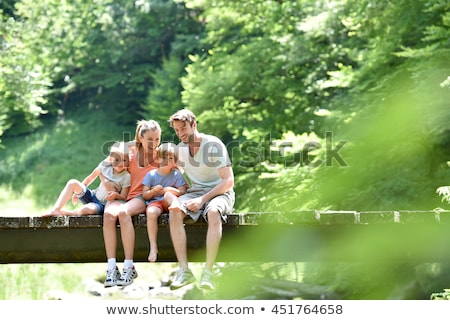 Stock photo: family of four on bridge