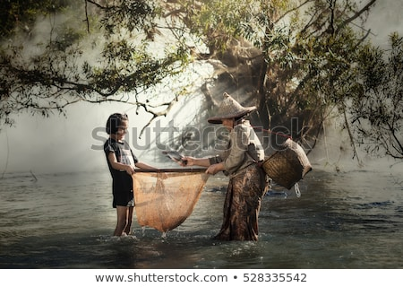 Grandmother and granddaughter at the riverside Stock photo © photography33
