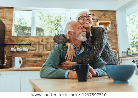 Elderly woman hugging her husband Stock photo © photography33