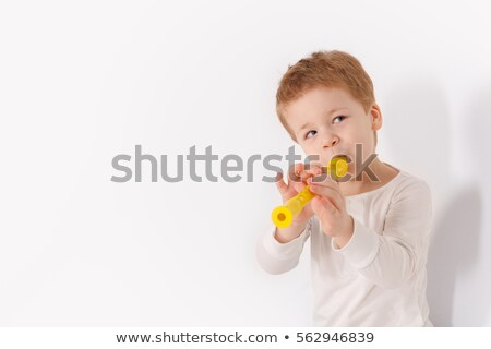 Young boy playing recorder Stock photo © bogumil