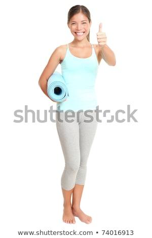 full length portrait of slim girl holding blue mat stock photo © stockyimages