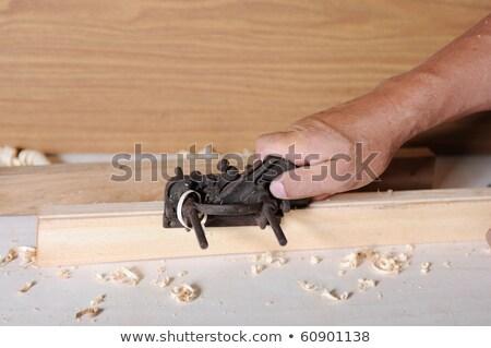 carpenter planning wood planer tool man hand Stock photo © lunamarina