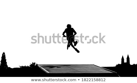 Erkek atlama rampa mutlu ışık bisiklet Stok fotoğraf © meinzahn