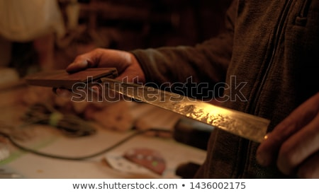 Male with a sharp knife in it's hand Stock photo © michaklootwijk