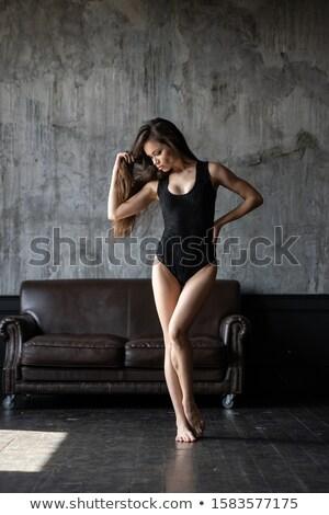 szexi · nő · sarkak · fekete · bőr · kanapé - stock fotó © chesterf