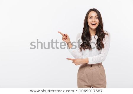 stijlvol · jonge · vrouw · wijzend · weg · glimlachend · modieus - stockfoto © stockyimages