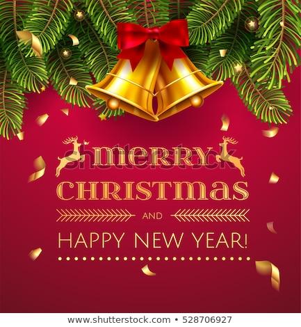 Arany karácsony harang vörös szalag fenyő dekoráció Stock fotó © LoopAll