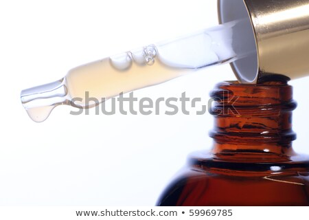Glass dropper filled with moisturizing concentrate Stock photo © FrameAngel
