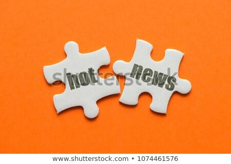 Hot News on Orange Puzzle. Stock photo © tashatuvango