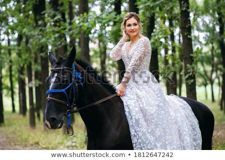 laughing lady walking with horse stock photo © konradbak