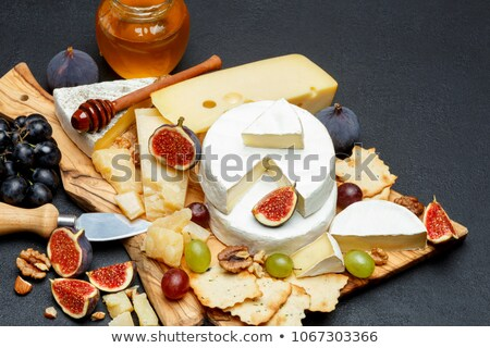 Segment of brie with grapes and a knife Stock photo © raphotos