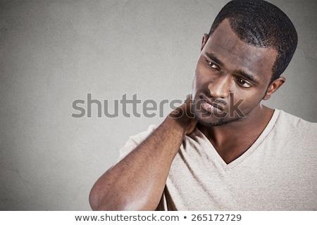 homem · sofrimento · moço · trabalhando · laptop - foto stock © deandrobot