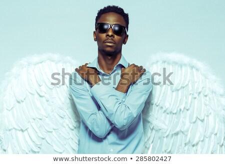 Homme ailes d'ange lunettes de soleil jeune homme beauté Photo stock © vlad_star
