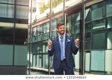 businessman celebrating his success outdoors stock photo © deandrobot