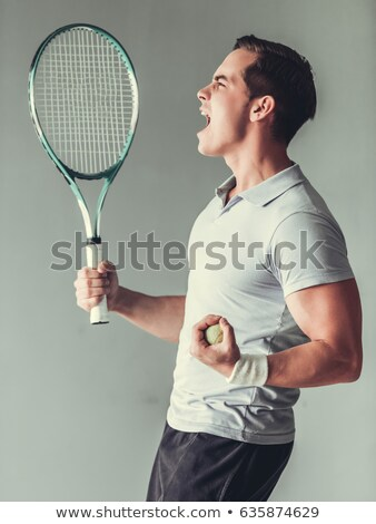 tennis player celebrating his victory stock photo © deandrobot