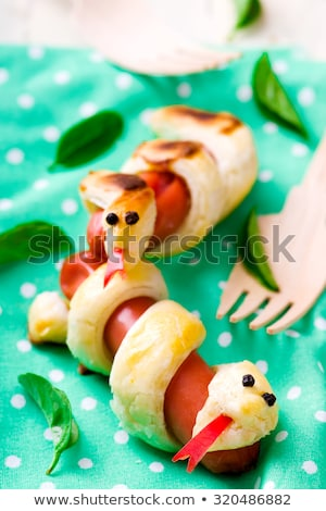 Stockfoto: Sausage Rolls In The Form Of A Snake