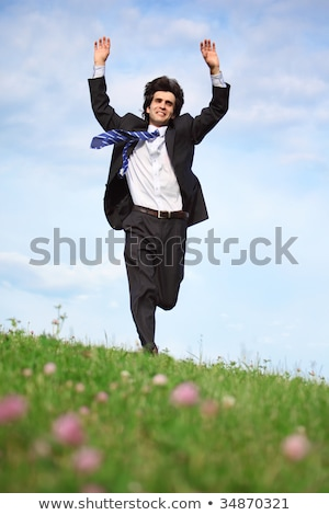 businessman runs on grass with lifted hands Stock photo © Paha_L