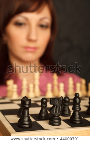 Girl with the sad looks on the chessboard. Close-up. Blur background. Stock photo © Paha_L