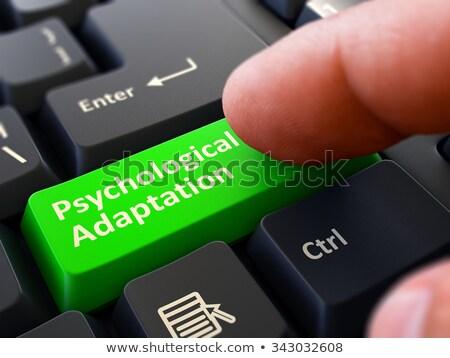 Finger Presses Green Keyboard Button Psychological Adaptation. Stock photo © tashatuvango
