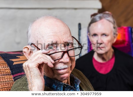 Stock photo: Angry senior man with mustache over white