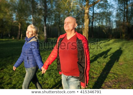 bald man walking and smiling stock photo © feedough