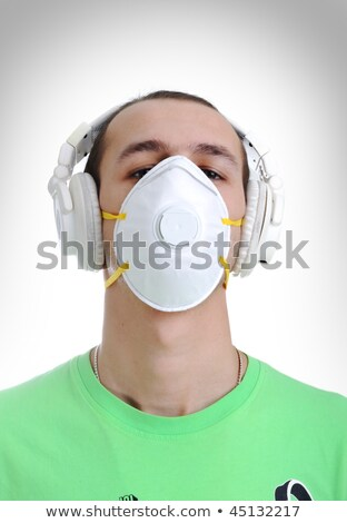 dj  Man wearing a mask as protection against the influenza virus.  Stock photo © zurijeta