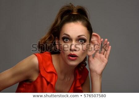 Woman with big ear concept Stock photo © zurijeta