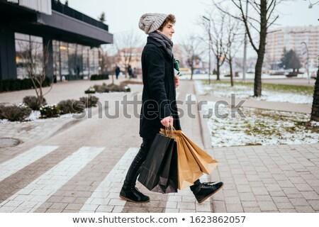 Young teenage person walking over pedestrian zebra crosswalk Stock photo © stevanovicigor