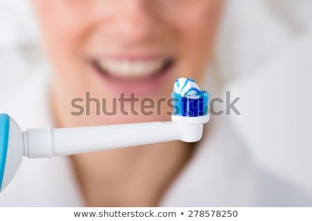 электрических зубная щетка белый синий трубка Сток-фото © juniart