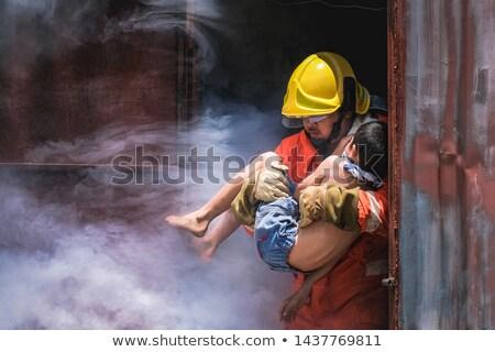 a fireman rescuing a girl stock photo © bluering