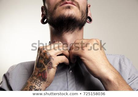 Foto stock: Ombre · con · tatuajes · y · piercings