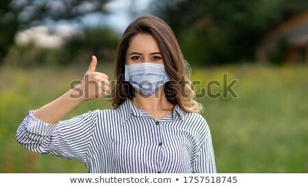 retrato · feminino · médico · enfermeira · máscara · cirúrgica - foto stock © deandrobot