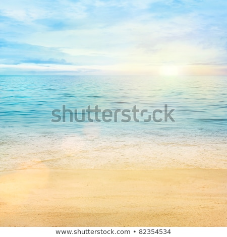 Beautiful beach with blue sea and sun ray reflected on the sea Stock photo © alphaspirit