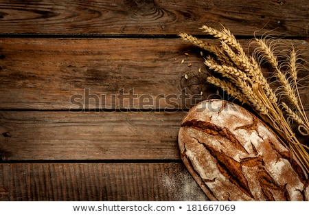 Rustic bread on wood table. Dark moody background with free text space. Stock photo © master1305