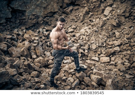 Bodybuilder strong as a rock Stock photo © zurijeta