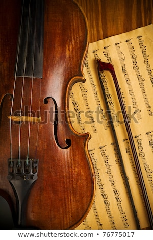 close up of musical instrument with sheet music on table stock photo © wavebreak_media
