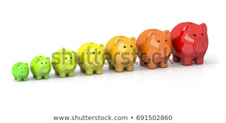 some piggy banks in different colors for energy efficiency Stock photo © magann