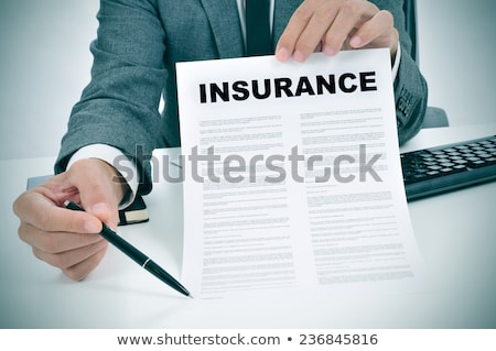 a young man in suit in his office showing an insurance policy an Stock photo © snowing