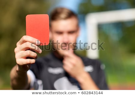 referee hands with red card on football field Stock photo © dolgachov