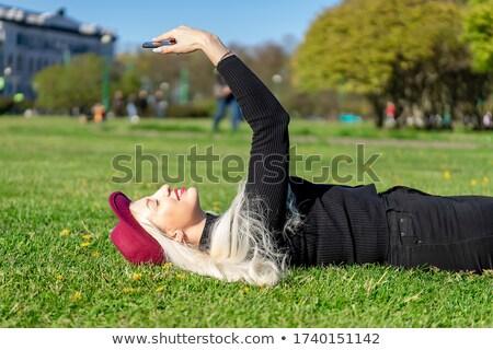 Alegre jovem senhora mentiras grama ao ar livre Foto stock © deandrobot