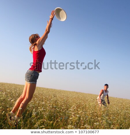 Couple jumping to catch a frisbee stock photo © IS2