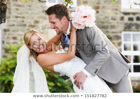 A wedding couple smiling to camera Stock photo © IS2