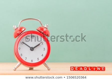 Business project deadline, vintage clock on office desk Stock photo © stevanovicigor
