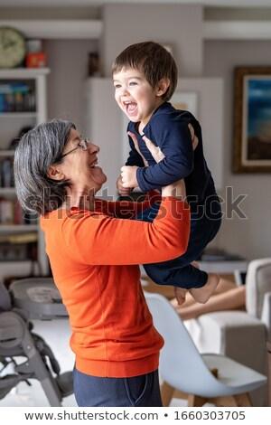 Senior Großmutter halten Enkel glücklich Stock foto © RAStudio