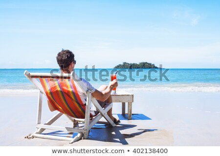Adam plaj bar içecekler egzotik kokteyl Stok fotoğraf © alexanderandariadna