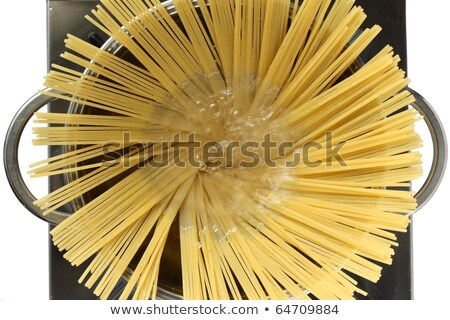 Stock photo: cook putting pasta into boiling water